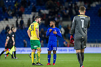 Grant Hanley of Norwich City speaks with Junior Hoilett of Cardiff City at full time of the Sky Bet Championship match between Cardiff City and Norwich City at the Cardiff City Stadium, Cardiff, Wales on 1 December 2017. Photo by Mark  Hawkins / PRiME Media Images.