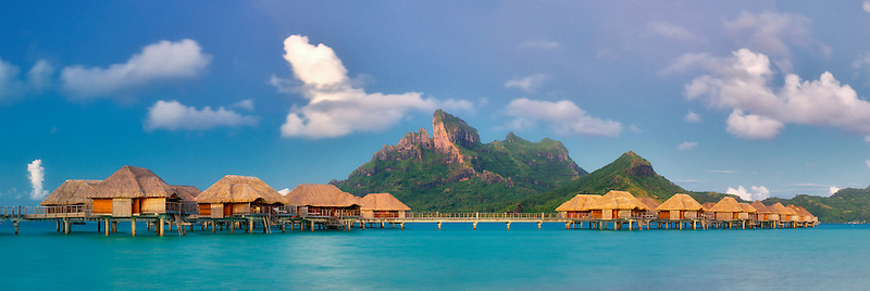 Sunrise and bungalows. Bora Bora. French Polynesia.