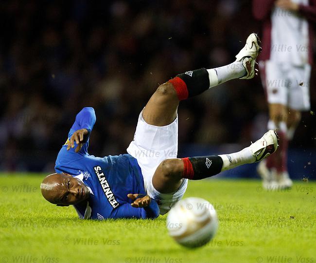 El Hadji Djouf bodychecked by Marius Zaliukas and takes a tumble, eye on the ball
