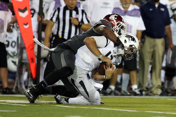 Ivan McLennan (3) sacks the quarterback during the Washington State Cougars non-conference road opener against the Nevada Wolfpack at Mackay Stadium in Reno, Nevada, on September 5, 2014.