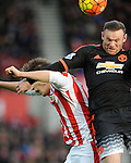 Wayne Rooney of Manchester United is challenged by Philipp Wollscheid of Stoke City<br /> - Barclays Premier League - Stoke City vs Manchester United - Britannia Stadium - Stoke on Trent - England - 26th December 2015 - Pic Robin Parker/Sportimage