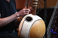 NWA Democrat-Gazette/J.T. WAMPLER Sean Gaskill plays a kora Sunday Jan. 6, 2019 at the Fayetteville Public Library. A kora is a 21-stringed instrument that's a cross between a lute and a harp from West Africa. For information about programs at the library visit www.faylib.org