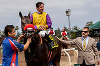ARCADIA, CA  JUNE 16: #6 Ollie's Candy, ridden by Kent Desormeaux, in the winners circle after winning the Summertime Oaks (Grade ll) on June 16, 2018 at Santa Anita Park in Arcadia, CA. (Photo by Casey Phillips/Eclipse Sportswire/Getty Images)