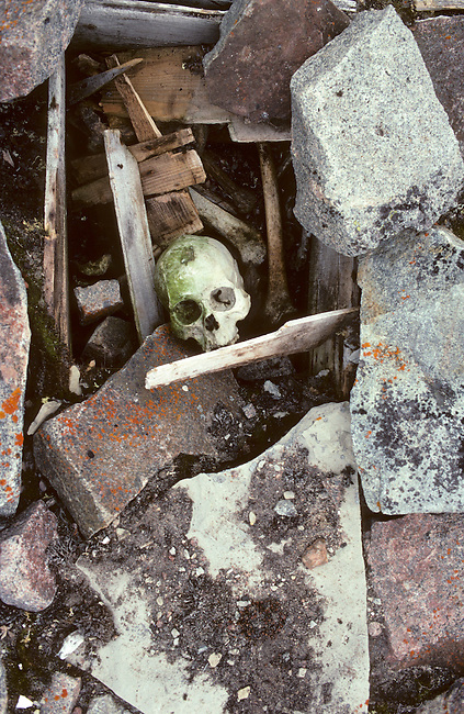 Inuit grave. The tundra throws back bodies after a number of years. Igloolik, Nunavut. Canada.