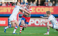 Picture by Allan McKenzie/SWpix.com - 17/04/2015 - Rugby League - Ladbrokes Challenge Cup - Wakefield Trinity Wildcats v Halifax RLFC - Rapid Solicitors Stadium, Wakefield, England - Halifax's Richard Moore fends off Wakefield's Tim Smith.