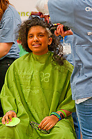 Both kids and adults had their heads shaved in a charity event to raise money to fight cancer. The event was held at Emerson Middle School in Park Ridge Illinois.