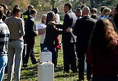 United States President Barack Obama (C) greets an unidentified woman as he spoke with veterans and their families on Veteran's Day while visiting Section 60 of Arlington National Cemetery, in Arlington, Virginia, USA, 11 November 2012. Section 60 is the final resting place for the majority of casualties at Arlington National Cemetery that died from Operation Iraqi Freedom in Iraq and Operation Enduring Freedom in Afghanistan..Credit: Michael Reynolds / Pool via CNP