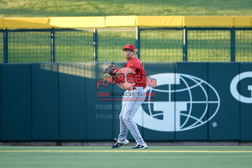 AZL Angels left fielder Jose Reyes (12) throws to the infield during an Arizona League game against the AZL Cubs 1 on June 24, 2019 at Sloan Park in Mesa, Arizona. AZL Cubs 1 defeated the AZL Angels 12-0. (Zachary Lucy / Four Seam Images)
