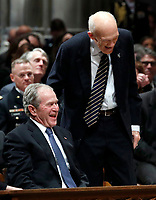 Former Sen. Alan Simpson, R-Wyo, center, speaks with former President George Bush, right, as he walks to a podium to speak during the State Funeral for former President George H.W. Bush at the National Cathedral, Wednesday, Dec. 5, 2018, in Washington. <br /> Credit: Alex Brandon / Pool via CNP / MediaPunch