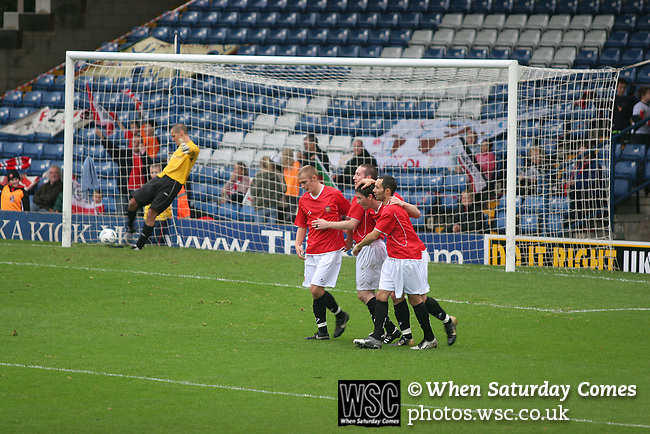 FC United of Manchester 8, Glossop North End 0, 28/10/2006. Gigg Lane, Bury, North West Counties League division one. Players of FC United of Manchester celebrate one of their goals against Glossop North End (blue shirts) in a North West Counties division one match at United's home stadium, Gigg Lane, home to Bury FC which United won 8-0. The match was staged on People United Day, an event started in 1999 which brought together fans from across Europe to campaign against racism. FC United were formed in the summer of 2005 by supporters of Manchester United in response to the take over of their club by American millionaire Malcolm Glazer and his family. The club entered the football pyramid at the lowest level with the intention to climbing through the leagues. FCUM won the match 8-0, watched by 3257 spectators. Photo by Colin McPherson.