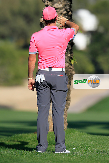 Rory MCILROY (NIR) prepares to play his 2nd shot from behind a tree on the 13th hole during Pink Friday's Round 2 of the 2015 Omega Dubai Desert Classic held at the Emirates Golf Club, Dubai, UAE.: Picture Eoin Clarke, www.golffile.ie: 1/30/2015