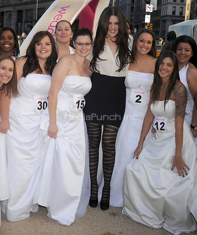 NEW YORK - NOVEMBER 09: Khloe Kardshin poses for a photo with brides during the Wedding Central 'If The Shoe Fits' Stunt at Madison Square Park.  Reality star Khloe Kardashian(C) meets with group of 30 brides as they race to find a designer shoe that fits among hundreds of shoe boxes during ' If the Shoe Fits' the Wedding Central's Ultimate Wedding Showdown at Madison Square Park November 9, 2010 in New York. Hoo-me.com / MediaPunch<br /> <br /> People:  Khloe Kardashian<br /> <br /> Transmission Ref:  MNC1<br /> <br /> Hoo-Me.com/ MediaPunch