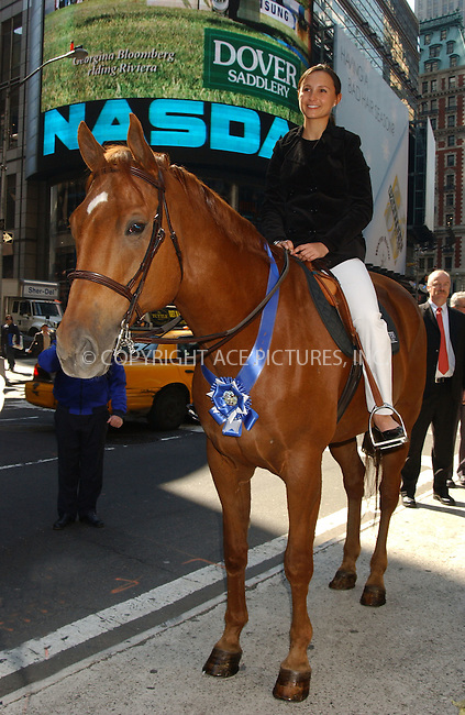 WWW.ACEPIXS.COM . . . . . ....March 30 2006, New York City....Mayor Michael Bloomberg and his daughter Georgina, who is and expert horsewoman, ring the opening bell and welcome Dover Saddlery to the Nasdaq Exchange. Subsequently Georgina posed in Times Square on horseback.......Please byline: KRISTIN CALLAHAN - ACEPIXS.COM.. . . . . . ..Ace Pictures, Inc:  ..Philip Vaughan (212) 243-8787 or (646) 769 0430..e-mail: info@acepixs.com..web: http://www.acepixs.com