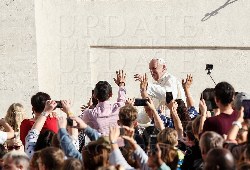 Pope Francis waves to the faithful as he arrives to attend his weekly general audience in St. Peter's Square at the Vatican City, October 16, 2019. <br /> UPDATE IMAGES PRESS/Riccardo De Luca<br /> <br /> STRICTLY ONLY FOR EDITORIAL USE