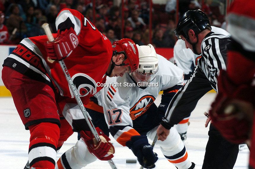 New York Islanders' Shawn Bates (17) faces off against the Carolina Hurricanes' Eric Staal, left, during their game Thursday, Jan. 19, 2006 in Raleigh, NC. Carolina won 4-3.