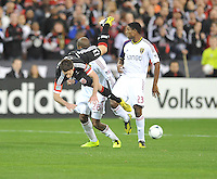 Chris Pontius (13) of D.C. United gets tackle form Real Salt Lake Khari Stephenson (23) D.C. United defeated Real Salt Lake 1-0 in their home opener, at RFK Stadium, Saturday March 9, 2013.