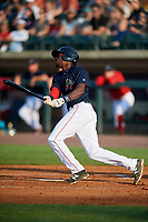 Lowell Spinners first baseman Xavier LeGrant (15) follows through on a swing during a game against the Vermont Lake Monsters on August 25, 2018 at Edward A. LeLacheur Park in Lowell, Massachusetts.  Vermont defeated Lowell 4-3.  (Mike Janes/Four Seam Images)