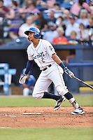 Asheville Tourists right fielder Yonathan Daza (2) swings at a pitch during a game against the  Greenville Drive at McCormick Field on June 3, 2016 in Asheville, North Carolina. The Tourists defeated the Drive 6-5. (Tony Farlow/Four Seam Images)