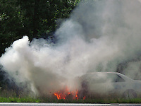 Toyota Camry On Fire By Jonathan Green