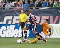 New England Revolution defender Andrew Farrell (2) avoids a tackle by Houston Dynamo forward Brad Davis (11).  The New England Revolution played to a 1-1 draw against the Houston Dynamo during a Major League Soccer (MLS) match at Gillette Stadium in Foxborough, MA on September 28, 2013.