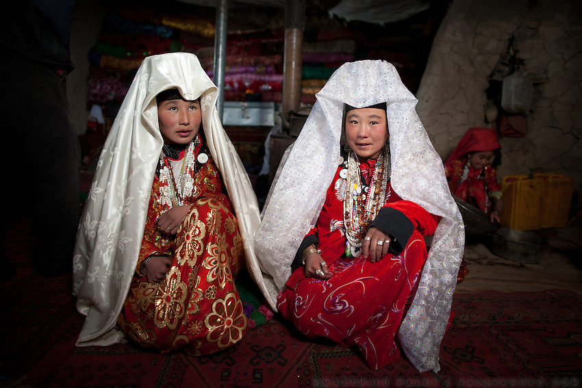 Two sisters: Irasia (L) and Ikhbal, recently married. Portraits inside the home of Noor Ali. At the Andemin camp...Trekking through the high altitude plateau of the Little Pamir mountains, where the Afghan Kyrgyz community live all year, on the borders of China, Tajikistan and Pakistan.