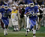 UK cornerback Randall Burden scores a touchdown after a 50yd interception return in the fourth quarter of the UK vs. Louisiana Monroe game at Commonwealth Stadium on Saturday, Oct. 24, 2009. The Wildcats beat the Warhawks 36-13. Photo by Adam Wolffbrandt | Staff