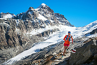 Trail running near the Chamanna Coaz (Coaz Hut) with the glaciers of the Piz Roseg in the background, in the Rosegtal above Pontresina, Switzerland