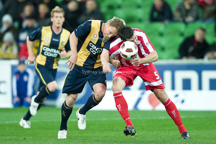 MELBOURNE, AUSTRALIA - AUGUST 5, 2010: Michael Beauchamp from the Heart and Daniel McBreen from the Mariners compete for the ball in Round 1 of the 2010 A-League between the Melbourne Heart and Central Coast Mariners at AAMI Park on August 5, 2010 in Melbourne, Australia. (Photo by Sydney Low / www.syd-low.com)
