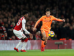 Arsenal's Ainsley Maitland-Niles tussles with Liverpool's Philippe Coutinho during the premier league match at the Emirates Stadium, London. Picture date 22nd December 2017. Picture credit should read: David Klein/Sportimage