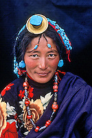 Kham, Tibet 2004. Tibetan woman wearing turquoise, Kham Eastern Tibet., 2004