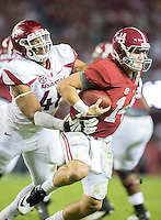NWA Democrat-Gazette/JASON IVESTER <br /> Arkansas defensive lineman Deatrich Wise Jr. (48) grabs onto Alabama quarterback Jake Coker (14) for a sack during the third quarter on Saturday, Oct. 10, 2015, at Bryant-Denny Stadium in Tuscaloosa, Ala.