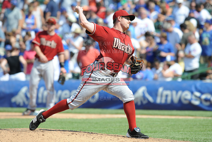 Arizona Diamondbacks pitcher Bryan Shaw #39 delivers  a pitch during a game against the Chicago Cubs at Wrigley Field on July 15, 2012 in Chicago, Illinois. The Cubs defeated the Diamondbacks 3-1. (Tony Farlow/Four Seam Images).