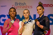 22nd March 2018, Arena Birmingham, Birmingham, England; Gymnastics World Cup, day two, womens competition; Angelina Melnikova (RUS) on the Podium after holding her Gold Medal along with Silver Medalist Margzetta Frazier (USA) and Bronze Medalist Alice Kinsella (GBR)
