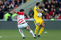 Matty Blair of Doncaster Rovers and Jordan Ayew of Crystal Palace during Doncaster Rovers vs Crystal Palace, Emirates FA Cup Football at the Keepmoat Stadium on 17th February 2019
