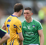 Kevin Harnett of Clare and Peter Nash of Limerick meet following their Munster championship quarter-final game in Cusack park. Photograph by John Kelly.