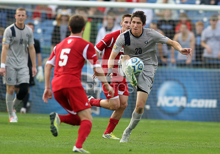 HOOVER, AL - DECEMBER 09, 2012: Matt McKain (5) of Indiana University moves in on Andy Riemer (20) of Georgetown University during the NCAA 2012 Men's College Cup championship, at Regions Park, in Hoover , AL, on Sunday, December 09, 2012.