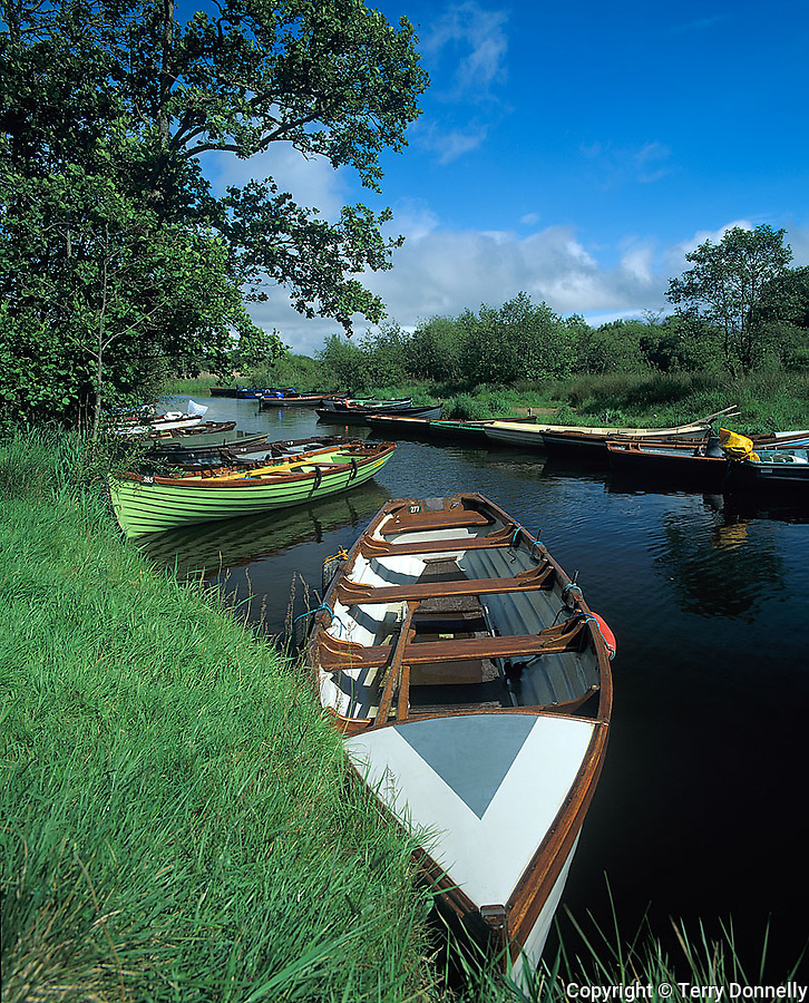 County Kerry, Killarney National Park, Ring of Kerry, Ireland          <br /> Wooden fishing boats moored on the waterway near Ross Bay of Lough Leane