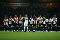 Brentford players show their respect for Gordon Banks who passed away this week, with a minute's applause pre-match during Brentford vs Aston Villa, Sky Bet EFL Championship Football at Griffin Park on 13th February 2019