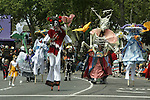 Stilt walkers with the group Catrinas, march in the 21st annual Summer Solstice Parade held Saturday, June 20, 2009 in Seattle, Wa. The parade was held Saturday, bringing out painted and naked bicyclists, bands, belly dancers and floats. (Jim Bryant Photo © 2009)