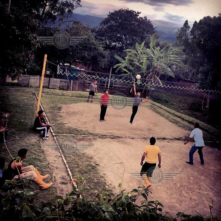 Men play Ecuavoley at dusk in Chiviqui.