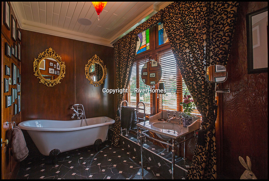 BNPS.co.uk (01202 558833)<br /> Pic: RiverHomes/BNPS<br /> <br /> The ultimate party pad...<br /> <br /> From the outside this 130-year-old Swiss chalet looks like a quirky old-fashioned property - but inside its the ultimate luxury home with a heated indoor beach, gold-covered bathroom and £500,000 kitchen.<br /> <br /> The Chalet Estate on the River Thames, next to Hampton Court Palace, is the ideal house for a wealthy party animal who wants to throw elaborate soirees.<br /> <br /> It is on the market with Riverhomes for £7.5million, but that's a bargain as the current owner has spent £4.7million completely overhauling the unusual property.