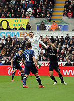 Pictured: Michu of Swansea (TOP) against Scott Parker (8) and Michael Dawson (R) of Tottenham (R). Saturday 30 March 2013<br />