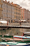 Canal Grande with boats and a pedestrian bridge in Trieste, Italy