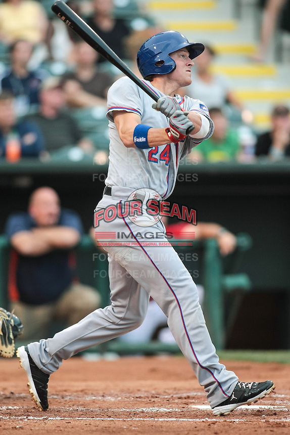 Jim Adduci (24) of the Round Rock Express at bat during the Pacific Coast League game against the Oklahoma City RedHawks at Chickashaw Bricktown Ballpark on June 14, 2013 in Oklahoma City ,Oklahoma.  (William Purnell/Four Seam Images)