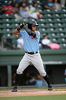 First baseman Jose Almonte (9) of the Hickory Crawdads bats in a game against the Greenville Drive on Wednesday, May 15, 2019, at Fluor Field at the West End in Greenville, South Carolina. Greenville won, 6-5. (Tom Priddy/Four Seam Images)