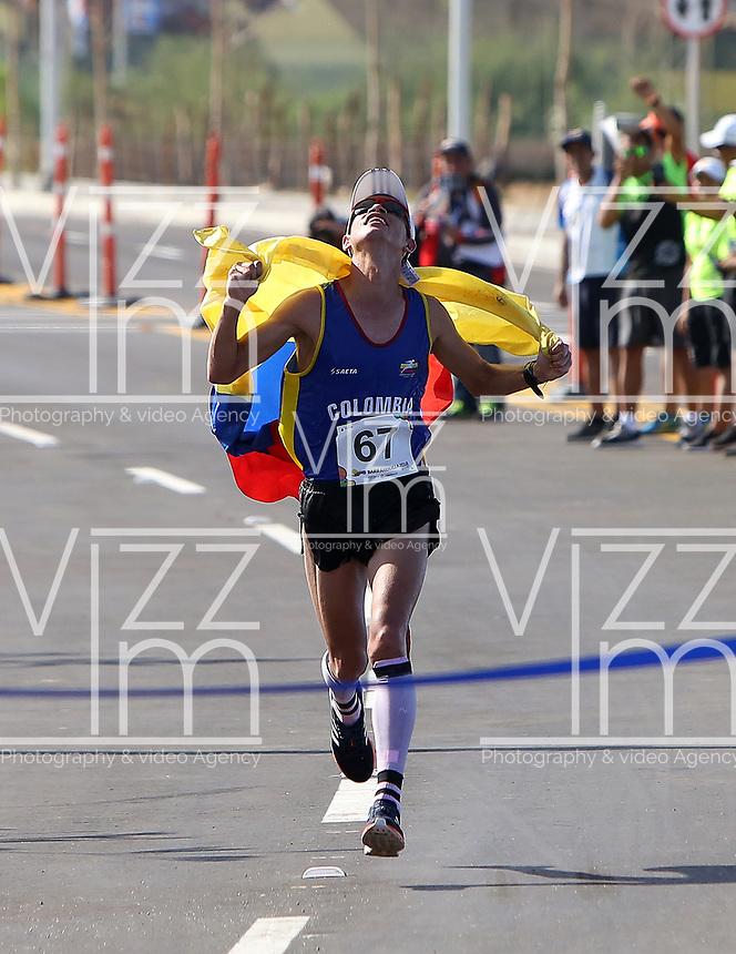 BARRANQUILLA - COLOMBIA, 03-08-2018: SUAREZ BOCANEGRA Jeisson Alexander (Colombia) ganador de la medalla de oro en su participación en maratón masculina como parte de los Juegos Centroamericanos y del Caribe Barranquilla 2018. /  SUAREZ BOCANEGRA Jeisson Alexander (Colombia) winner of the gold medal in his participation in men's marathon of the Central American and Caribbean Sports Games Barranquilla 2018. Photo: VizzorImage /  Cont