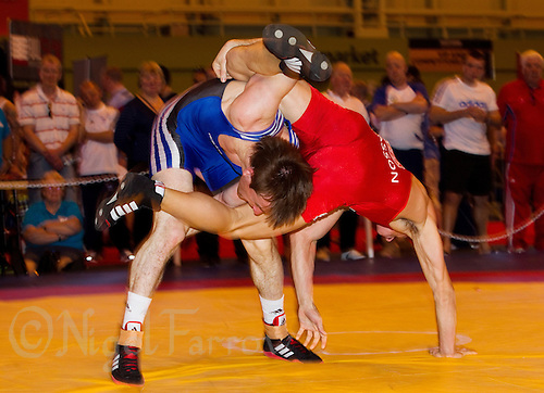 22 MAY 2010 - BIRMINGHAM, GBR - Terence Bosson (red) v Oleksandr Madyarchyk (blue)  2010 English Senior Wrestling Championships (PHOTO (C) NIGEL FARROW)
