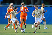 21 August 2011:  FIU's Marie Egan (13) and Crystal McNamara (15) keep the ball moving in the second half as the University of Florida Gators defeated the FIU Golden Panthers, 2-0, at University Park Stadium in Miami, Florida.