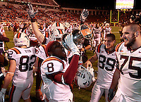 CHARLOTTESVILLE, VA- NOVEMBER 12: Cornerback Detrick Bonner #8 of the Virginia Tech Hokies celebrates with teammates after the 38-0 win over the Virginia Cavaliers on November 28, 2011 at Scott Stadium in Charlottesville, Virginia.  (Photo by Andrew Shurtleff/Getty Images) *** Local Caption *** Detrick Bonner