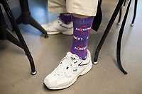 NWA Democrat-Gazette/CHARLIE KAIJO Mark Linkous of Rogers shows his sock during the Creative Connections event at the Crystal Bridges museum in Bentonville, AR on Monday, September 11, 2017. Creative Connections is a program for individuals in the early stages of Alzheimer&acirc;&euro;&trade;s or dementia and their care partners. Museum Educators facilitate interactive discussions of artworks in the galleries, followed by hands-on art activities in the studio. The discussions on the works are designed to stimulate memories and emotions between Alzheimer's patients and their caretakers. <br /><br />Links sells socks through an organizations called &quot;Sock it to Alzheimer's&quot;, which he said, all the proceeds go to support Alzheimers associations. He said that he had lost his mother to Alzheimer's and now he and his wife are on the journey. He also participates in the walks for a cure events including the upcoming one at the Northwest Arkansas Community College this coming Saturday. &quot;One of the slogans I came up with is I walk everyday for Alzheimer's and my socks show it,&quot; he said.